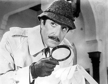 Inspector Clouseau, possibly searching for a document